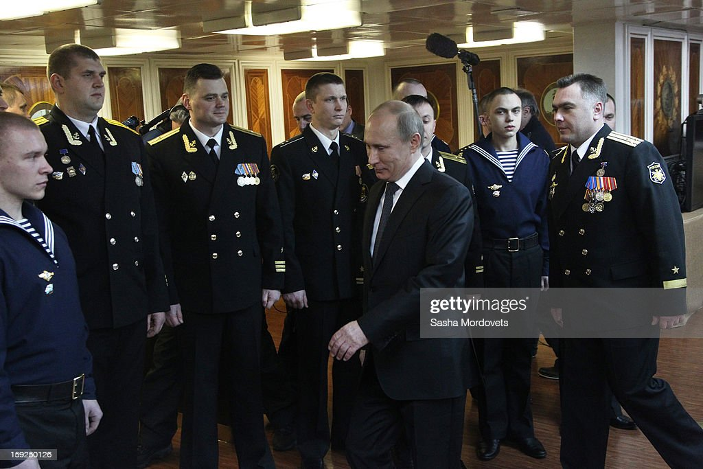 Russian President Vladimir Putin (C) visits the heavy nuclear-powered missile cruiser Pyotr Veliky at the Russian Northern Fleet's base January 10, 2013 in Severomorsk, Russia. Putin awarded the crew of the Pyotr Veliky the Nakhimov order.