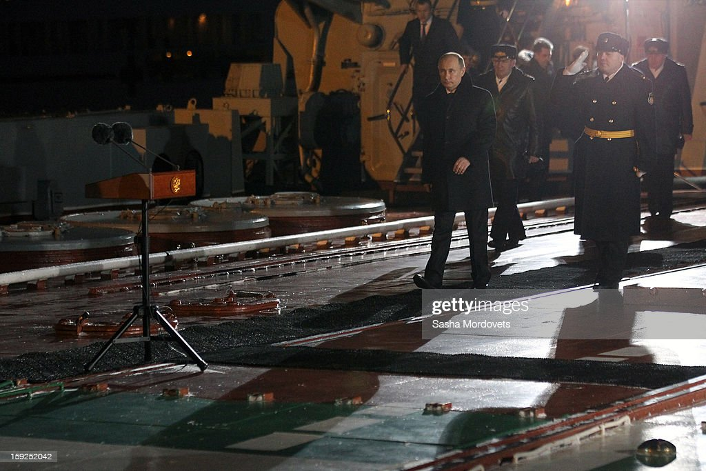 Russian President Vladimir Putin (L) visits the heavy nuclear-powered missile cruiser Pyotr Veliky at the Russian Northern Fleet's base January 10, 2013 in Severomorsk, Russia. Putin awarded the crew of the Pyotr Veliky the Nakhimov order.