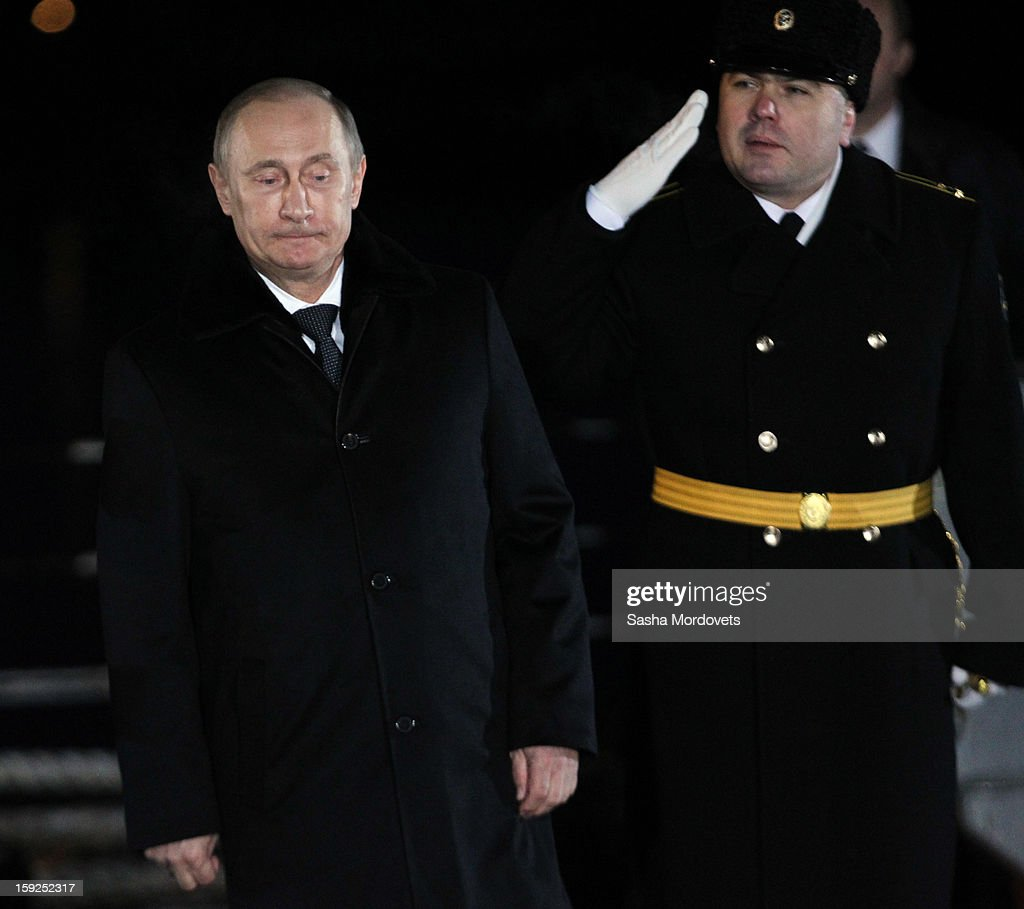 Russian President <a gi-track='captionPersonalityLinkClicked' href=/galleries/search?phrase=Vladimir+Putin&family=editorial&specificpeople=154896 ng-click='$event.stopPropagation()'>Vladimir Putin</a> (L) visits the heavy nuclear-powered missile cruiser Pyotr Veliky at the Russian Northern Fleet's base January 10, 2013 in Severomorsk, Russia. Putin awarded the crew of the Pyotr Veliky the Nakhimov order.