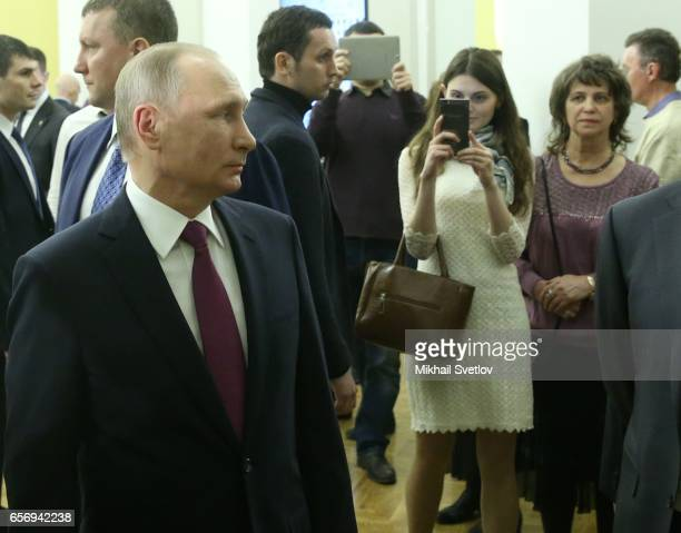 Russian President Vladimir Putin visits the Maly Theatre to watch the comedy 'The Last Victim' by Russian writer Alexander Ostrovsky on March 23 2017...