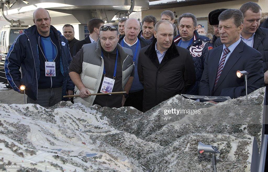 Russian President Vladimir Putin (2nd R) visits the Rosa Khutor Alpine Centre, one of the Sochi 2014 Winter Olympic venues, near the Black Sea city of Sochi, on February 6, 2013 with the head of the Sochi 2014 Olympic preparatory commission Deputy Prime Minister Dmitry Kozak (R) and Sochi 2014 CEO Dmitry Chernyshenko (L) accompanying Putin. AFP PHOTO / POOL/ IVAN SEKRETAREV
