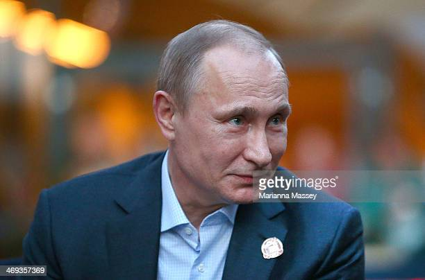 Russian President Vladimir Putin visits USA House in the Olympic Village on February 14 2014 in Sochi Russia