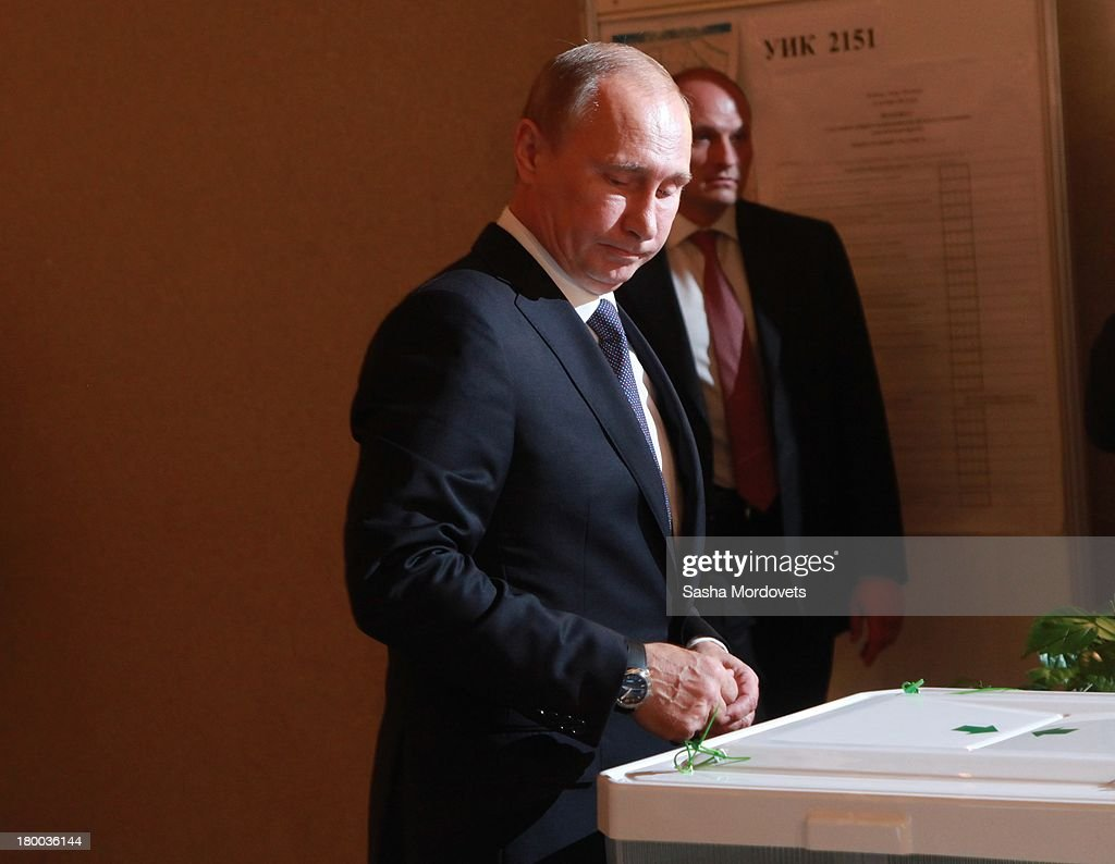 Russian President <a gi-track='captionPersonalityLinkClicked' href=/galleries/search?phrase=Vladimir+Putin&family=editorial&specificpeople=154896 ng-click='$event.stopPropagation()'>Vladimir Putin</a> votes at the mayoral elections at the polling station on September 08, 2013 in Moscow, Russia. Opposition leader Alexey Navalny, one of Putin's most vocal critics is a candidate for mayor in Moscow.