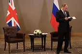 Russian President Vladimir Putin waits for the arrival of British Prime Minister David Cameron ahead of their bilateral meeting on day two of the G20...