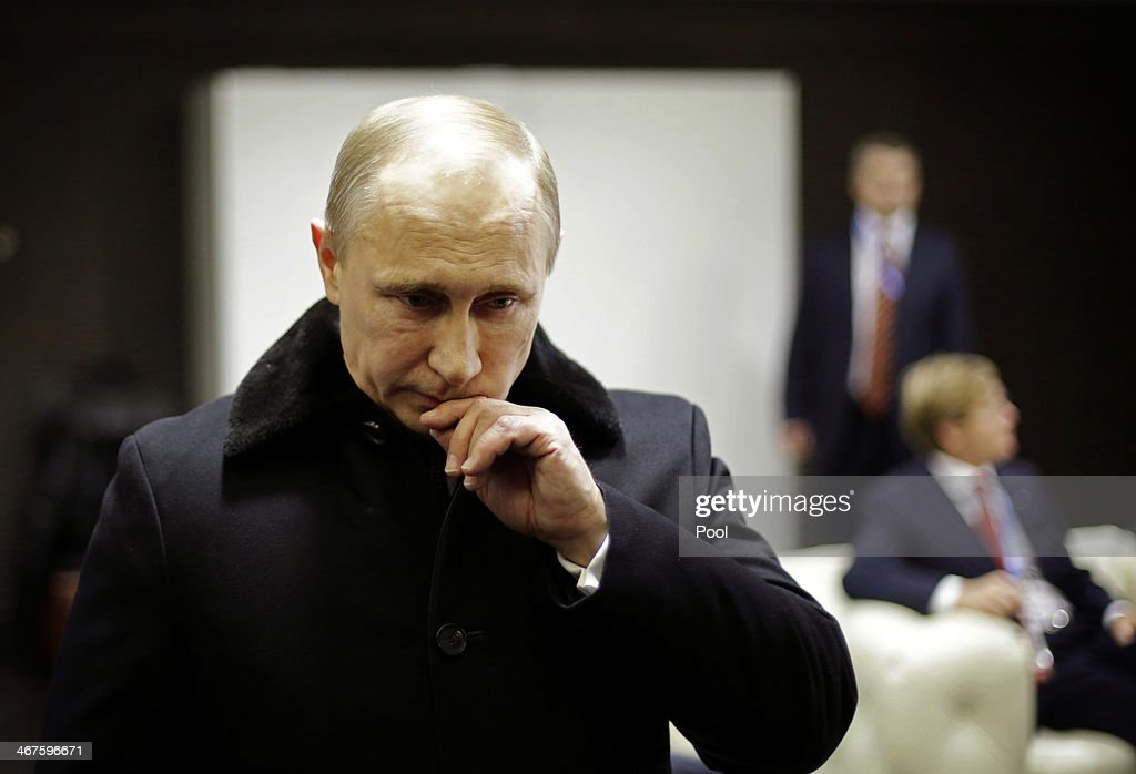 Russian President Vladimir Putin waits in the presidential lounge to be introduced at the opening ceremony of the Sochi 2014 Winter Olympics at the...