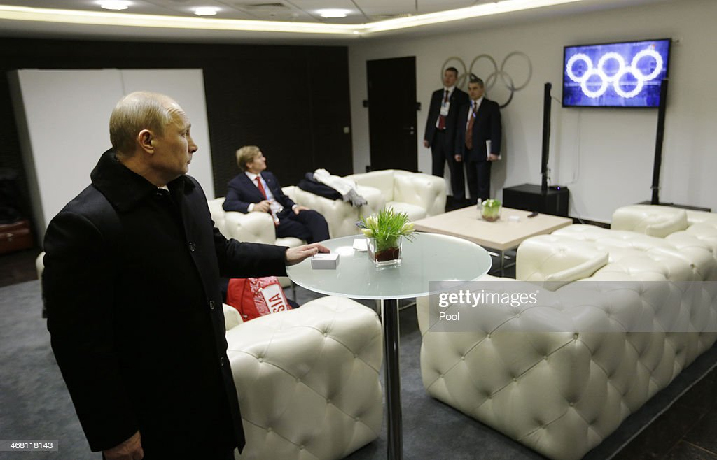 Russian President <a gi-track='captionPersonalityLinkClicked' href=/galleries/search?phrase=Vladimir+Putin&family=editorial&specificpeople=154896 ng-click='$event.stopPropagation()'>Vladimir Putin</a> waits in the presidential lounge to be introduced at the opening ceremony of the Sochi 2014 Winter Olympics as a television screen displays five Olympic rings at the Fisht Olympic Stadium on February 7, 2014 in Sochi, Russia.