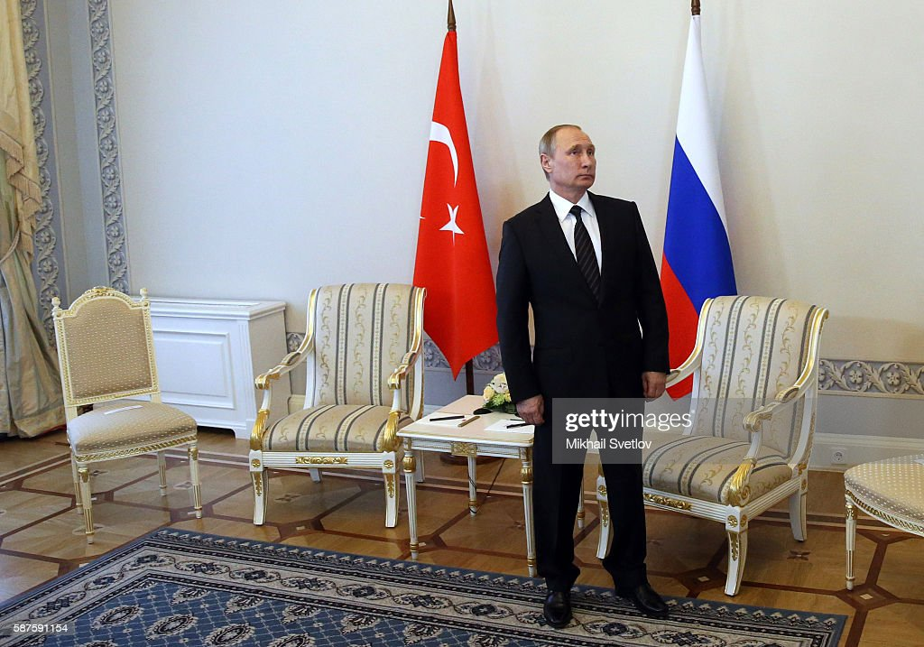 Russian President Vladimir Putin waits to greet Turkish President Recep Tayyip Erdogan during their meeting in Konstantin Palace August 2016 in...