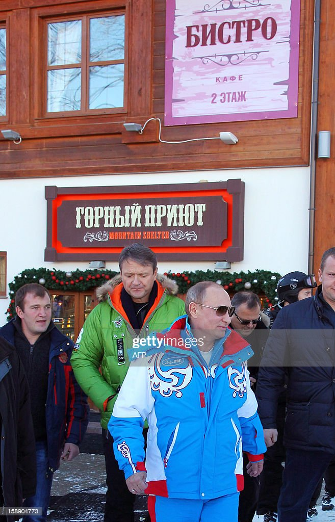 Russian President Vladimir Putin (C) walks during his visit to the mountain resort in Krasnaya Polyana outside the Russian Black Sea resort of Sochi on January 3, 2013.