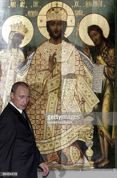 Russian President Vladimir Putin walks in front of an icon during the opening ceremony at the Guggenheim Museum in New York 14 September 2005 The...