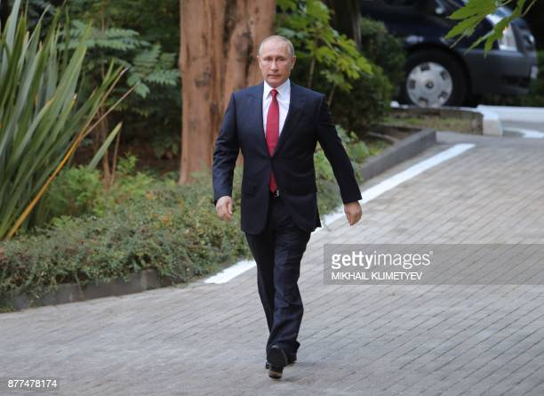 Russian President Vladimir Putin walks to attend a trilateral meeting on Syria with his Turkish and Iranian counterparts in Sochi on November 22 2017...