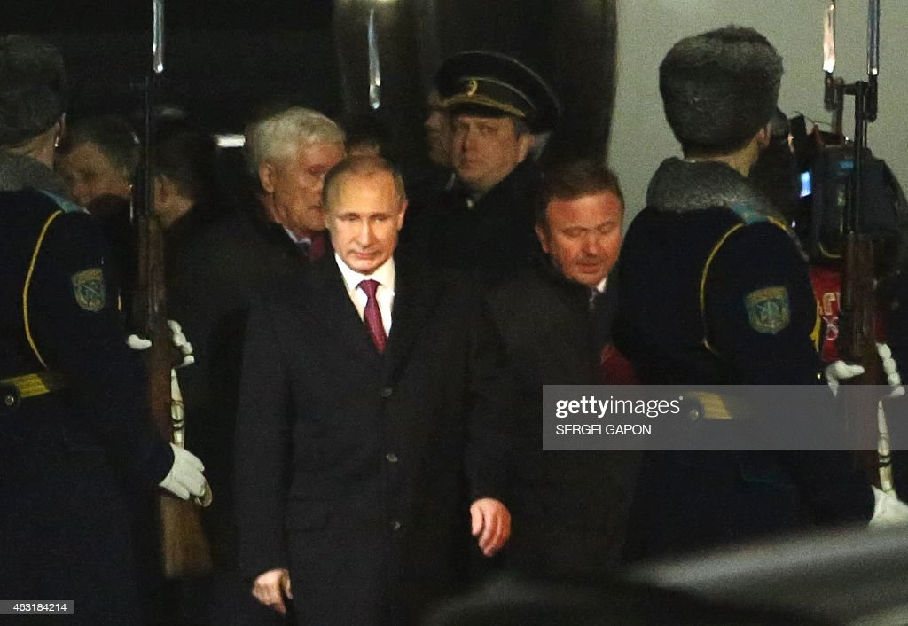 Russian President Vladimir Putin walks upon his arrival in Minsk on February 11 2015 Leaders of Ukraine Russia Germany and France are to hold a...