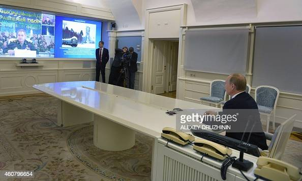 Russian President Vladimir Putin watches a live broadcast of a launch from Russian Plesetsk cosmodrome in a presidential situation centre in Moscow...