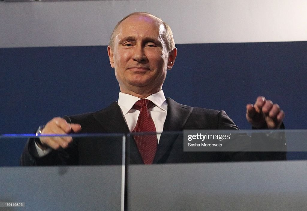 Russian President <a gi-track='captionPersonalityLinkClicked' href=/galleries/search?phrase=Vladimir+Putin&family=editorial&specificpeople=154896 ng-click='$event.stopPropagation()'>Vladimir Putin</a> watches the closing ceremony of the 2014 Paralympic Winter Games on March 16, 2014 in Sochi,Russia.