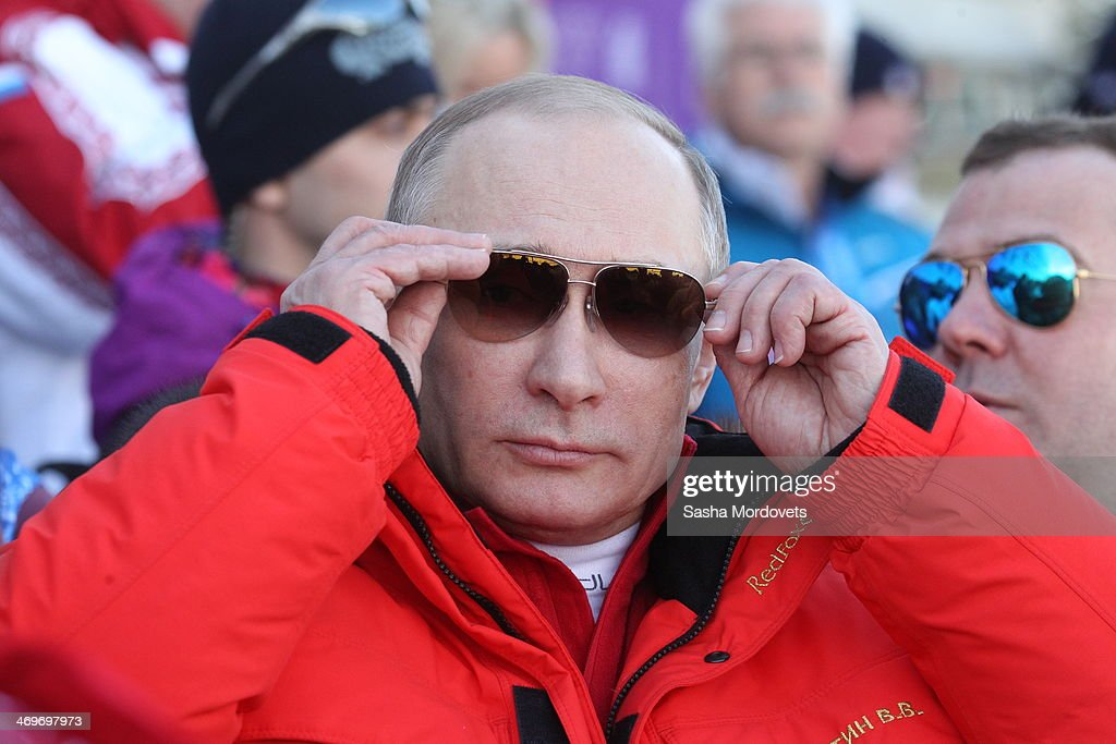 Russian President Vladimir Putin watches the men's 4x10 K cross-country relay at the 2014 Winter Olympics, on February 16, 2014 in Krasnaya Polyana, Sochi, Russia. Putin and Medvedev are spending the weekend together in Sochi.