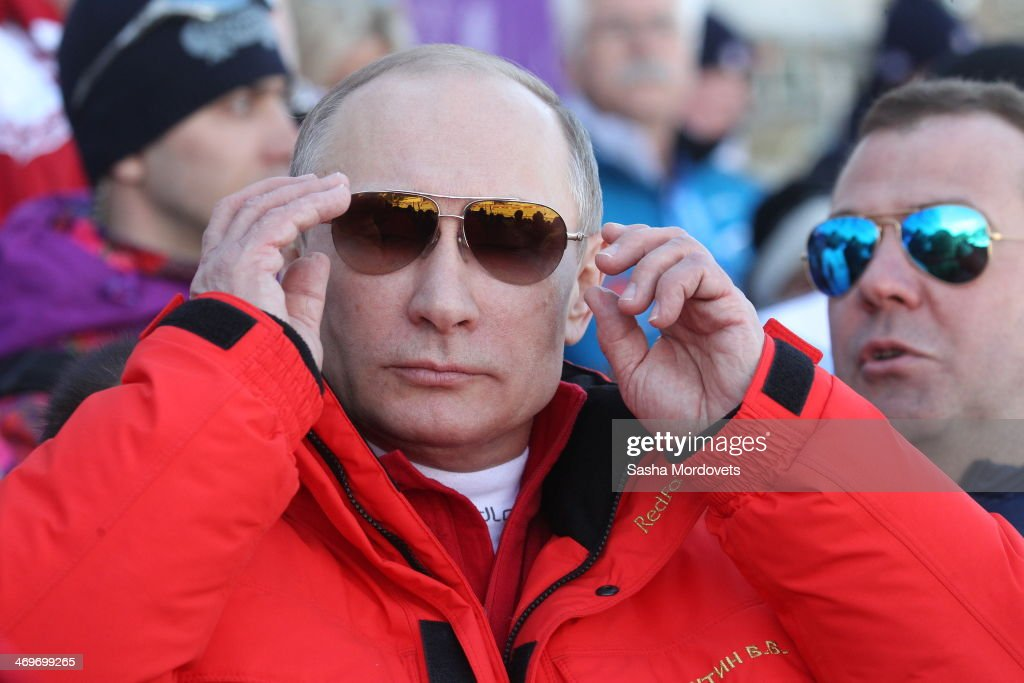 Russian President <a gi-track='captionPersonalityLinkClicked' href=/galleries/search?phrase=Vladimir+Putin&family=editorial&specificpeople=154896 ng-click='$event.stopPropagation()'>Vladimir Putin</a> watches the men's 4x10 K cross-country relay at the 2014 Winter Olympics, on February 16, 2014 in Krasnaya Polyana, Sochi, Russia. Putin and Medvedev are spending the weekend together in Sochi.