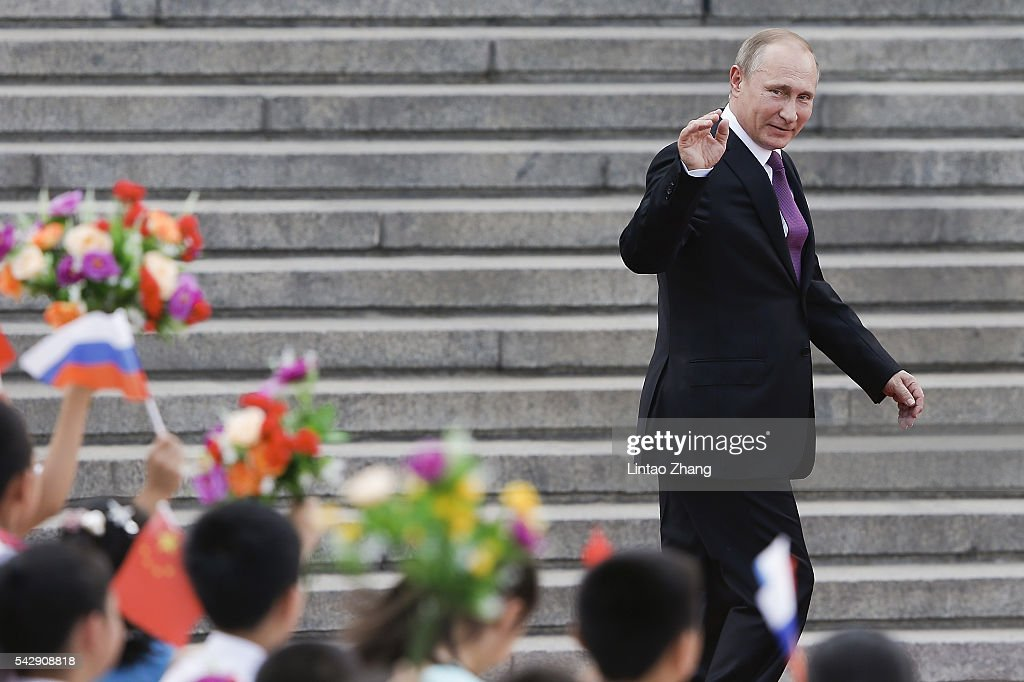 Russian President <a gi-track='captionPersonalityLinkClicked' href=/galleries/search?phrase=Vladimir+Putin&family=editorial&specificpeople=154896 ng-click='$event.stopPropagation()'>Vladimir Putin</a> wave to Chinese children after a welcoming ceremony outside the Great Hall of the People on June 25, 2016 in Beijing, China. At the invitation of President Xi Jinping, Russian President <a gi-track='captionPersonalityLinkClicked' href=/galleries/search?phrase=Vladimir+Putin&family=editorial&specificpeople=154896 ng-click='$event.stopPropagation()'>Vladimir Putin</a> is in China to discuss more economic and military cooperation between the two countries.