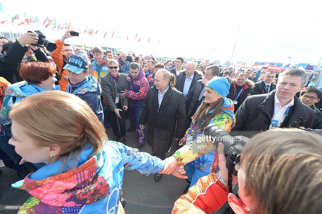 Russian President Vladimir Putin waves arrives at the Olympic village in Sochi on February 5, 2014, two days ahead of the opening ceremony for the Winter Olympics.