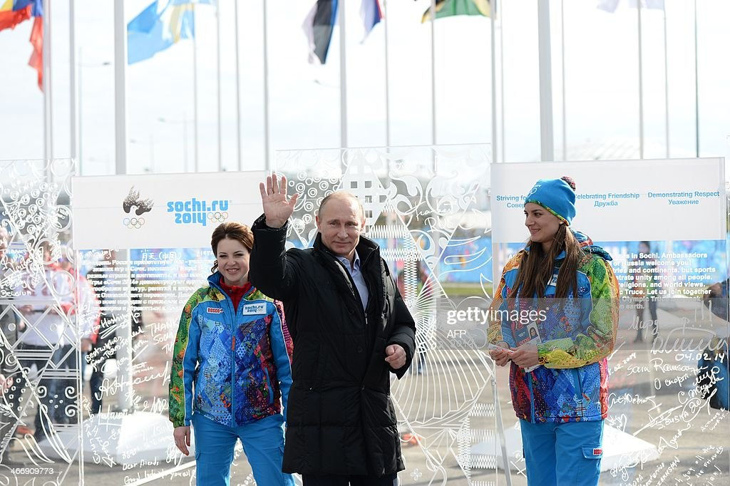 Russian President Vladimir Putin waves as he arrives at the Olympic village in Sochi on February 5, 2014, two days ahead of the opening ceremony for the Winter Olympics.