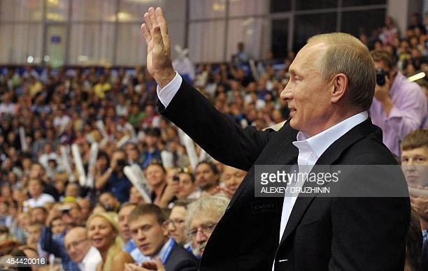 Russian President Vladimir Putin waves as he attends the World Judo Championships in Chelyabinsk on August 31 2014 AFP PHOTO / RIANOVOSTI / ALEXEY...