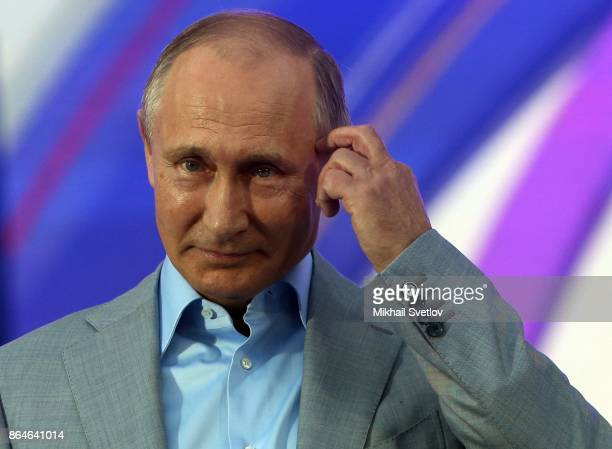 Russian President Vladimir Putin waves while visiting the 19th World Festival of Youth and Students on October 21 2017 in Sochi Russia 20000...