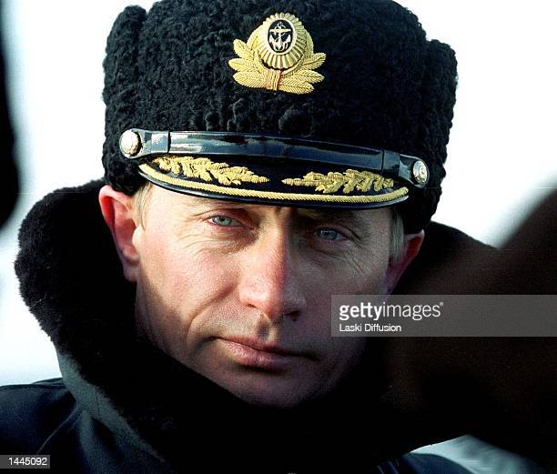 Russian President Vladimir Putin wearing a navy cap and greatcoat participates in naval exercises near Severomorsk Russia April 6 2000