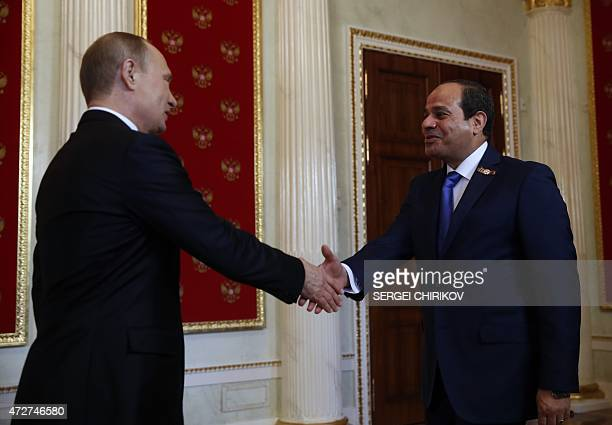 Russian President Vladimir Putin welcomes Egyptian President Abdel Fattah alSisi during the ceremony to welcome foreign delegation heads and honorary...