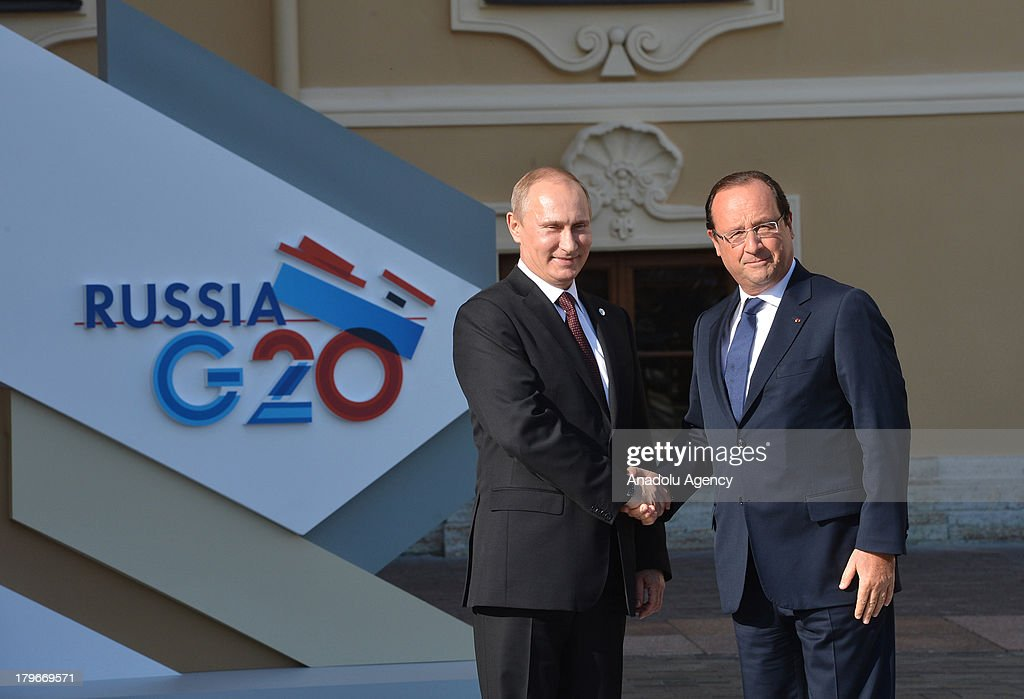 Russian President Vladimir Putin (L) welcomes French President Francois Hollande during arrivals for the G-20 summit at the Konstantin Palace in St. Petersburg, Russia on September 5,2013. The G20 summit begins on September 5, 2013 in Strelna of Saint Petersburg under Russian Presidency.