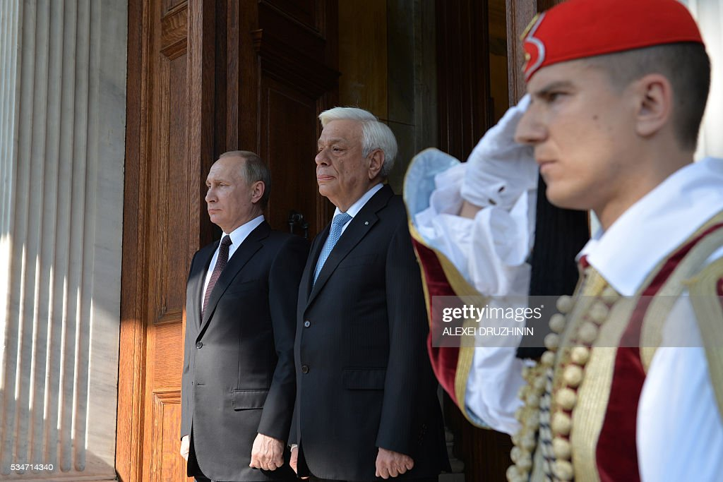 Russian President Vladimir Putin (L) welcomes Greek President Prokopios Pavlopoulos before a meeting in Athens on May 27, 2016. Russian President Vladimir Putin was in Greece on May 27 in a visit aimed at reinforcing a relationship with one of his few friends in the EU amid tensions with the West. The visit, Putin's first to the EU since December, comes at a low ebb in relations between Russia and Europe over the conflict in Ukraine that broke out in 2014, with sanctions still in force against Moscow. / AFP / SPUTNIK / Alexei Druzhinin