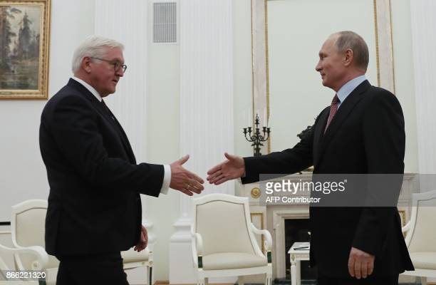 Russian President Vladimir Putin welcomes his German counterpart FrankWalter Steinmeier during a meeting at the Kremlin in Moscow on October 25 2017...