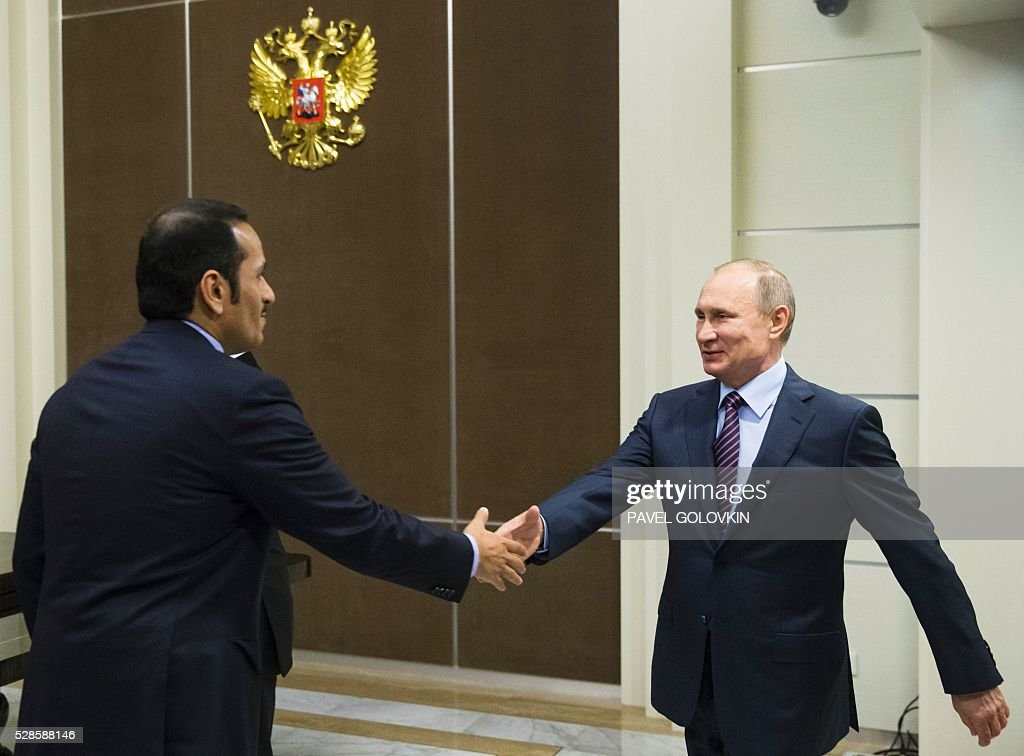 Russian President Vladimir Putin (R) welcomes Qatari Foreign Minister Sheikh Mohammed bin Abdulrahman Al-Thani during a meeting at the Bocharov Ruchei state residence in Sochi on May 6, 2016. / AFP / POOL / Pavel Golovkin