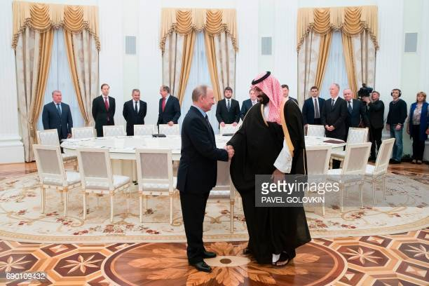 Russian President Vladimir Putin welcomes Saudi Deputy Crown Prince and Defence Minister Mohammed bin Salman during a meeting at the Kremlin in...