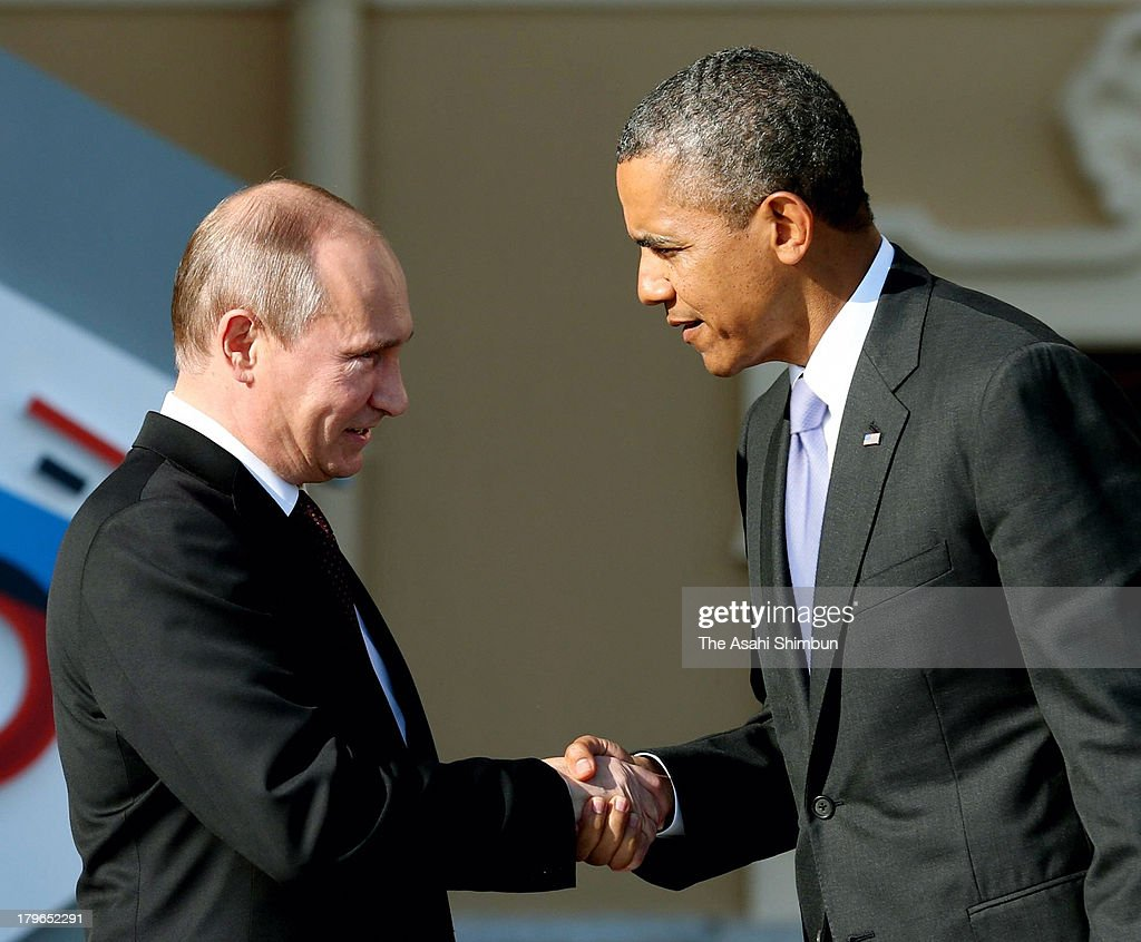 Russian President <a gi-track='captionPersonalityLinkClicked' href=/galleries/search?phrase=Vladimir+Putin&family=editorial&specificpeople=154896 ng-click='$event.stopPropagation()'>Vladimir Putin</a> (L) welcomes U.S. President <a gi-track='captionPersonalityLinkClicked' href=/galleries/search?phrase=Barack+Obama&family=editorial&specificpeople=203260 ng-click='$event.stopPropagation()'>Barack Obama</a> on September 5, 2013 in St. Petersburg, Russia. The G20 summit is expected to be dominated by the issue of military action in Syria while issues surrounding the global economy, including tax avoidance by multinationals, will also be discussed during the two-day summit.
