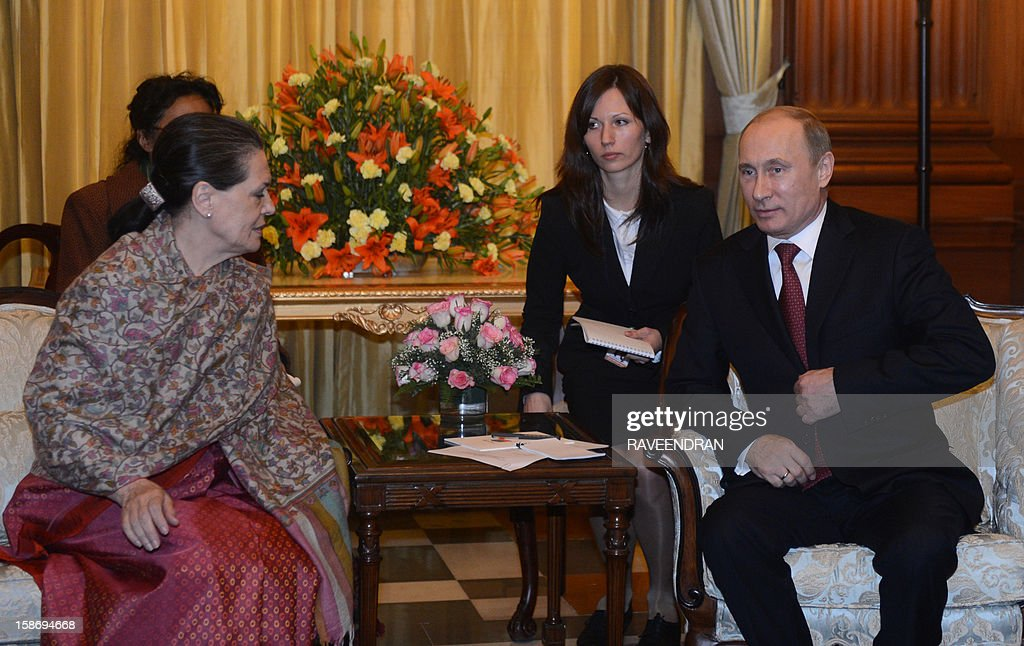 Russian President Vladirmir Putin (R) talks with Chairperson of the UPA Government Sonia Gandhi during a meeting at the Presidential Palace in New Delhi on December 24, 2012. Visiting Russian President Vladimir Putin signed deals to sell 71 military helicopters and kits to build 42 fighter jets to India on Monday as he sought to firm up ties with a traditional ally.