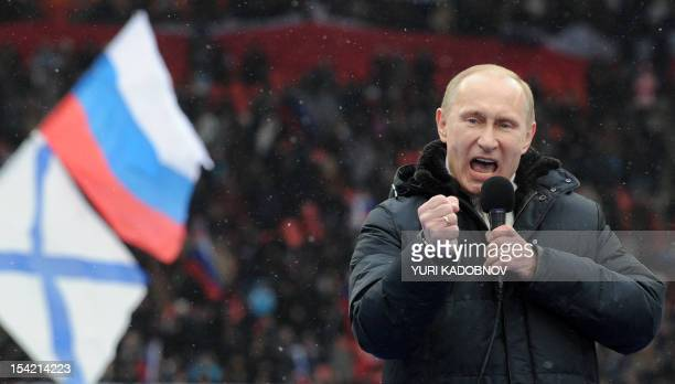 Russian Presidential candidate Prime Minister Vladimir Putin delivers a speech during a rally of his supporters at the Luzhniki stadium in Moscow on...