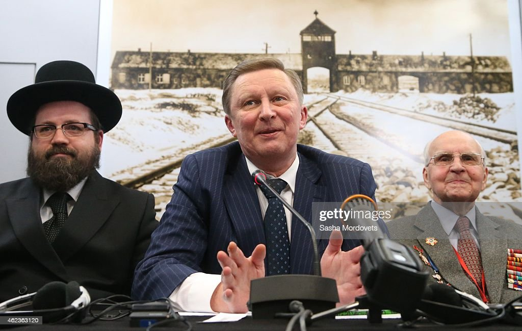 Russian Presidential Chief of Staff Sergei Ivanov followed by WWII veterans speaks at the Auschwitz Memorial Museum January 27 2015 in Oswiecim...