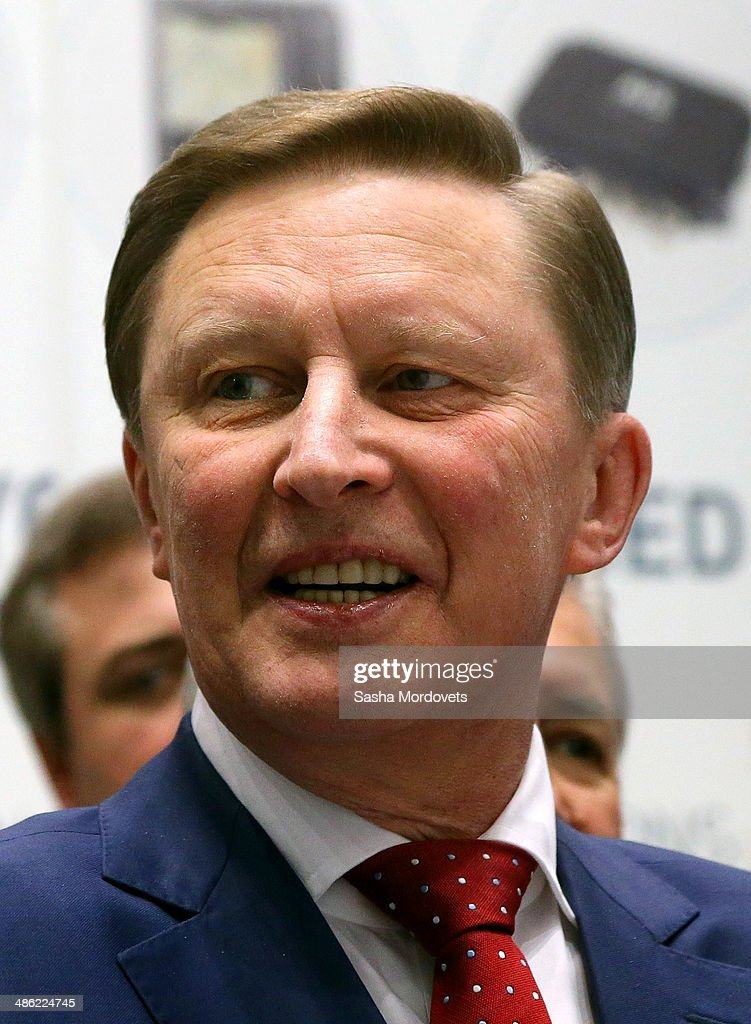 Russian Presidential Chief of Staff Sergei Ivanov observes a GLONASS exposition at the Navitech navigation forum on April 23 2014 in Moscow Russia