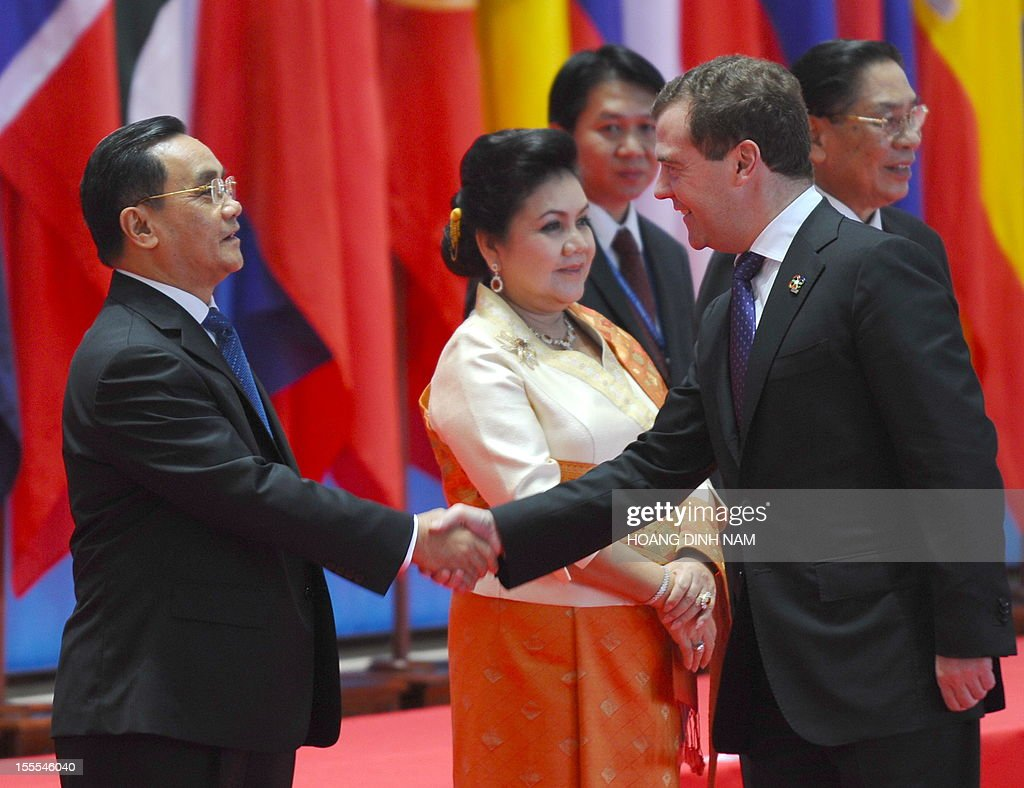 Russian Prime Minister Dmitri Medvedev (R) is greeted by Lao Prime Minister Thongsing Thammavong as he arrives to attend the opening of the ninth Asia-Europe (ASEM 9) summit in Vientiane on November 5, 2012. The two-day bi-annual summit began in the capital of the Southeast Asian landlock communist nation. AFP PHOTO/HOANG DINH Nam