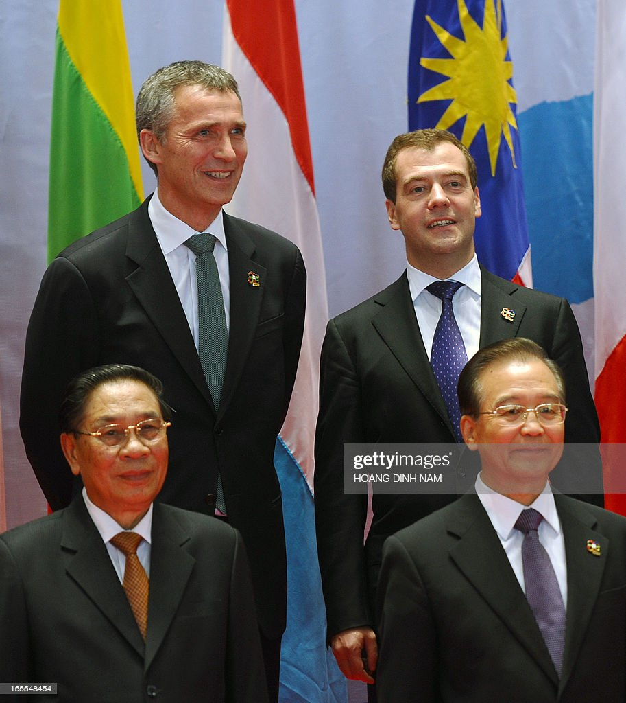 Russian Prime Minister Dmitri Medvedev (top R) stands next to Chinese Prime Minister Wen Jiabao (bottom R), Lao President Choummaly Sayasone (bottom L) and Norwegian Prime Minister Jens Stoltenberg (top L) as they prepare to pose for a group photo prior to the opening of the ninth Asia-Europe (ASEM 9) summit in Vientiane on November 5, 2012. Dozens of European and Asian leaders will gather in impoverished Laos on November 5 for a major summit set to be dominated by the eurozone debt crisis and growing territorial tensions in the region.