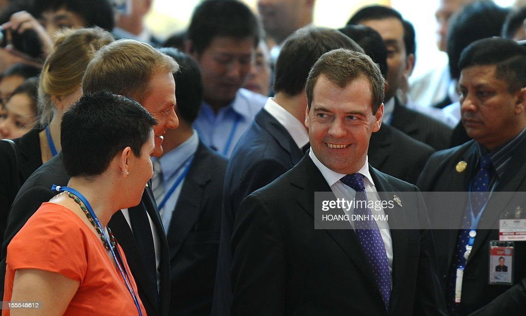 Russian Prime Minister Dmitri Medvedev (2nd R) talks with Polish Prime Minister Donalk Tusk (3rd L) as they leave the opening ceremony of the ninth Asia-Europe (ASEM 9) summit in Vientiane on November 5, 2012. The two-day bi-annual summit began in the capital of the Southeast Asian landlock communist nation. AFP PHOTO/HOANG DINH Nam