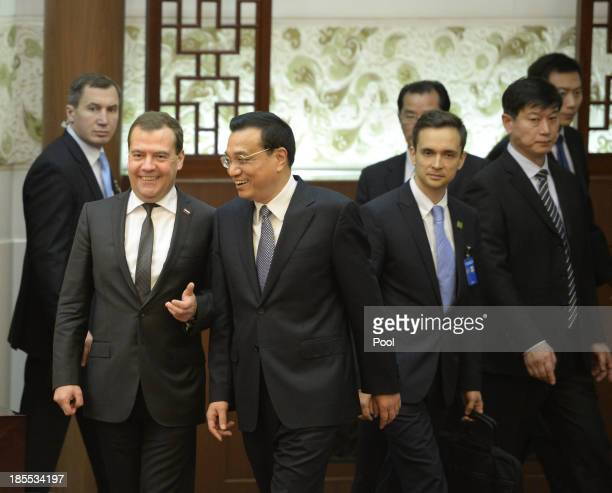 Russian Prime Minister Dmitry Medvedev and Chinese Premier Li Keqiang talk before a signing ceremony at the Great Hall of the People on October 22...