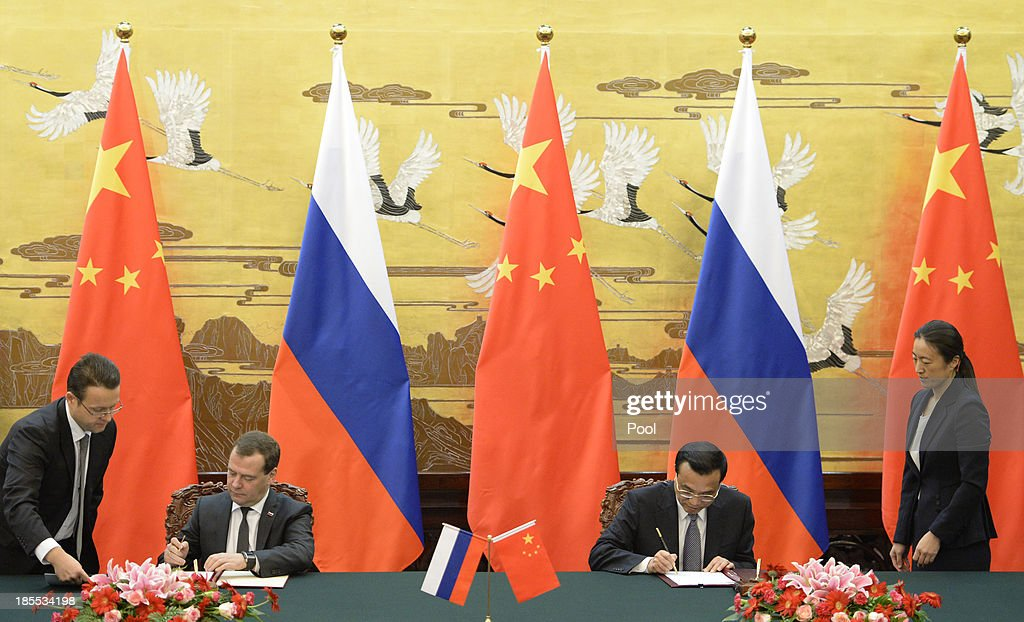 Russian Prime Minister Dmitry Medvedev and Chinese Premier Li Keqiang during a signing ceremony at the Great Hall of the People on October 22, 2013 in Beijing, China. Medvedev is in China on a two-day visit as a guest of Chinese Premier Li Keqiang to co-chair the 18th regular meeting between the Chinese and Russian heads of government.