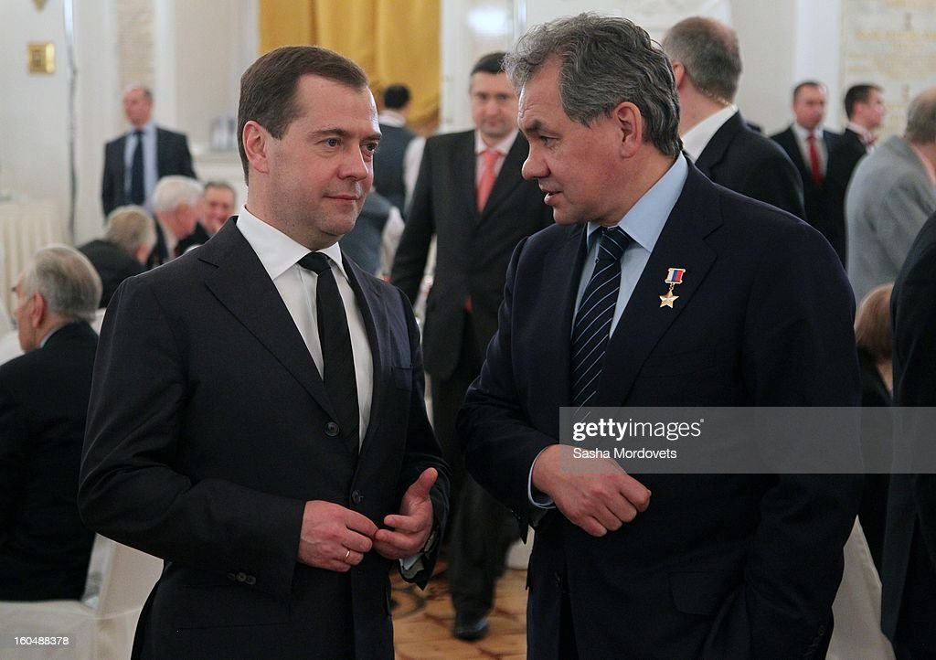 Russian Prime Minister <a gi-track='captionPersonalityLinkClicked' href=/galleries/search?phrase=Dmitry+Medvedev&family=editorial&specificpeople=554704 ng-click='$event.stopPropagation()'>Dmitry Medvedev</a> (L) and Defence Minister Sergey Shoigu (R) attend a meeting with veterans of the Battle of Stalingrad in the Grand Kremlin Palace February,1,2013 in Moscow, Russia. The meeting comes ahead of Putin's visit to Stalingrad tomorrow for a military parade commemorating the battle that proved pivotal in World War II.
