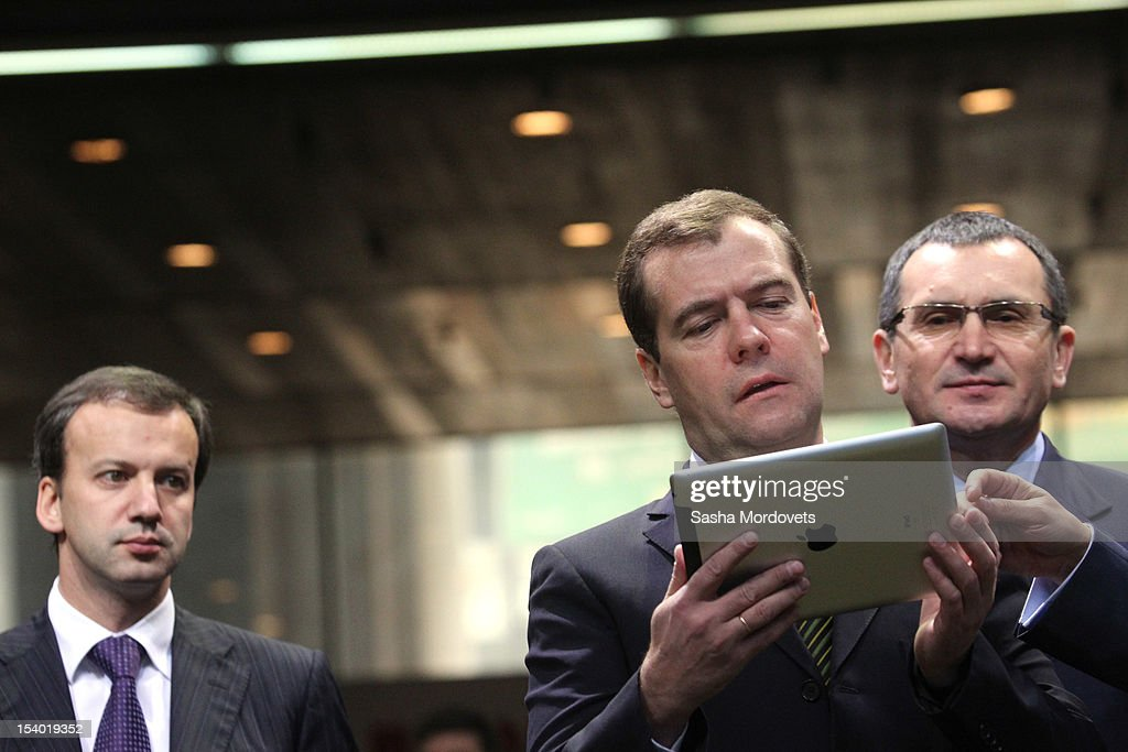 Russian Prime Minister Dmitry Medvedev (C) and Deputy Prime Minister Arkady Dvorkovich (L) visit an agricultural exhibition October 12, 2012 in Moscow, Russia. Earlier this week Medvedev and his Iraqi counterpart Nouri al-Maliki agreed that Iraq would buy more than $4.2 billion in arms from Russia.