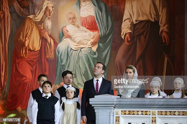 Russian Prime Minister Dmitry Medvedev and his spouse Svetlana Medvedeva attend a Christmas Mass in the Christ The Saviour Cathedral early January 7...