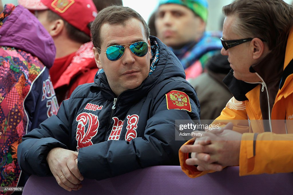 Russian Prime Minister <a gi-track='captionPersonalityLinkClicked' href=/galleries/search?phrase=Dmitry+Medvedev&family=editorial&specificpeople=554704 ng-click='$event.stopPropagation()'>Dmitry Medvedev</a> (L) and Latvia Bobsleigh team coach Zintis Ekmanis speak during the Men's Four-Man Bobsleigh on Day 16 of the Sochi 2014 Winter Olympics at Sliding Center Sanki on February 23, 2014 in Sochi, Russia.