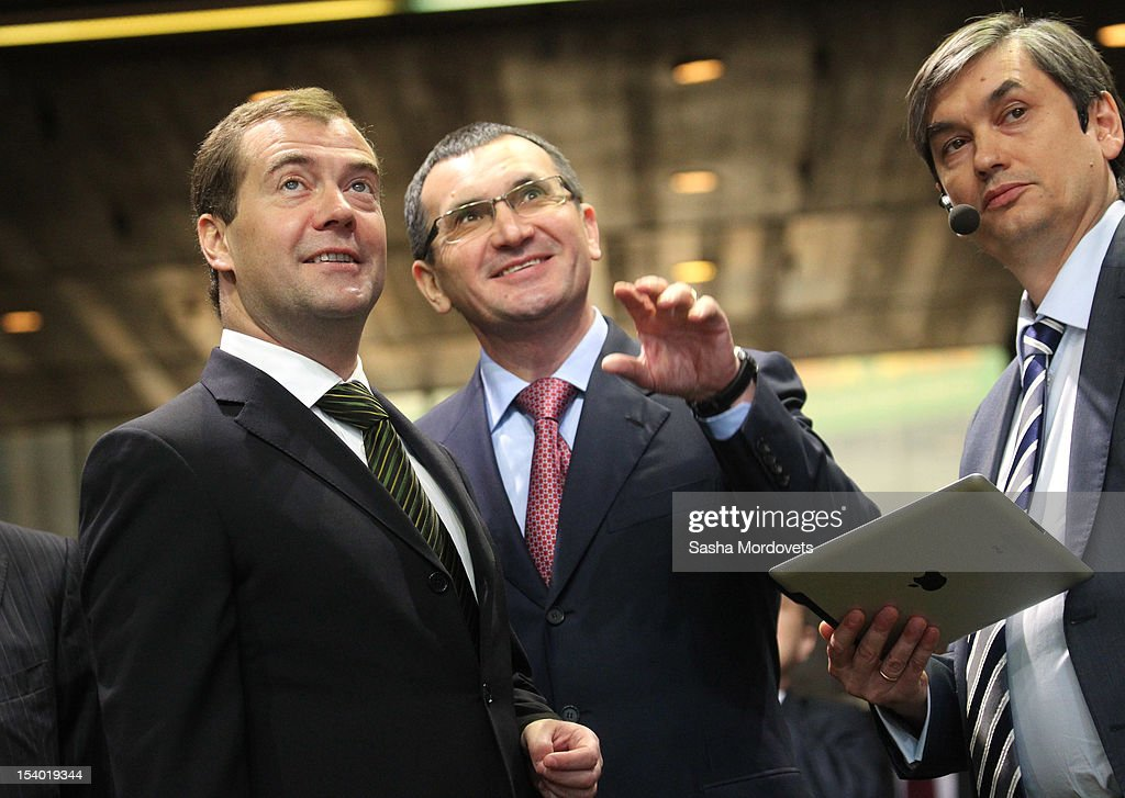 Russian Prime Minister Dmitry Medvedev (L) and Minister of Agriculture Nikolay Fyodorov (C) visit an agricultural exhibition October 12, 2012 in Moscow, Russia. Earlier this week Medvedev and his Iraqi counterpart Nouri al-Maliki agreed that Iraq would buy more than $4.2 billion in arms from Russia.