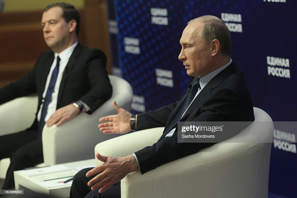Russian Prime Minister <a gi-track='captionPersonalityLinkClicked' href=/galleries/search?phrase=Dmitry+Medvedev&family=editorial&specificpeople=554704 ng-click='$event.stopPropagation()'>Dmitry Medvedev</a> and Russian President <a gi-track='captionPersonalityLinkClicked' href=/galleries/search?phrase=Vladimir+Putin&family=editorial&specificpeople=154896 ng-click='$event.stopPropagation()'>Vladimir Putin</a> (R) speak with activists of the ruling party United Russia on October 3, 2013 in Moscow, Russia. Putin meets the heads of grassroot organizations of the ruling United Russia party as part of the United Russia party congress.