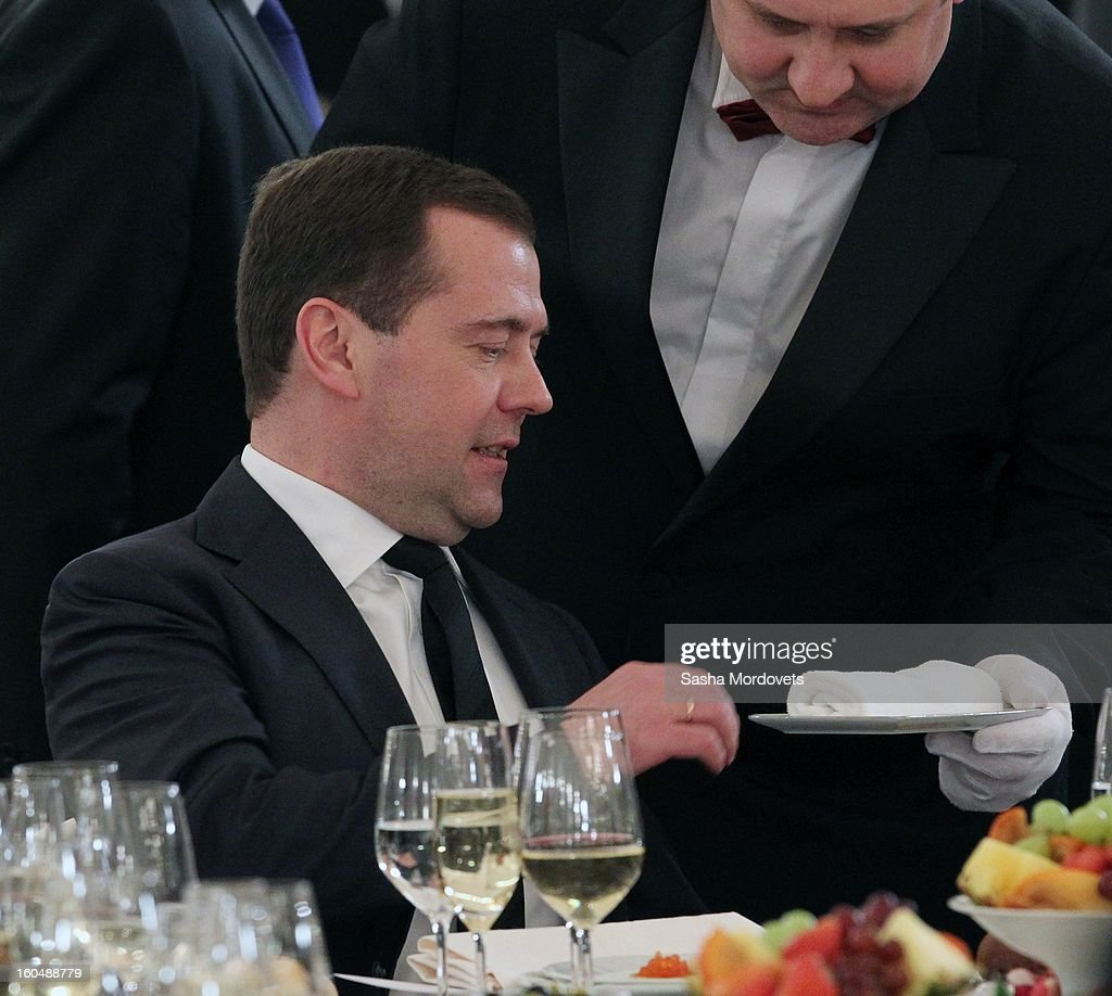 Russian Prime Minister <a gi-track='captionPersonalityLinkClicked' href=/galleries/search?phrase=Dmitry+Medvedev&family=editorial&specificpeople=554704 ng-click='$event.stopPropagation()'>Dmitry Medvedev</a> is handed a towel as he attends a meeting with veterans of the Battle of Stalingrad in the Grand Kremlin Palace February,1,2013 in Moscow, Russia. The meeting comes ahead of Putin's visit to Stalingrad tomorrow for a military parade commemorating the battle that proved pivotal in World War II.
