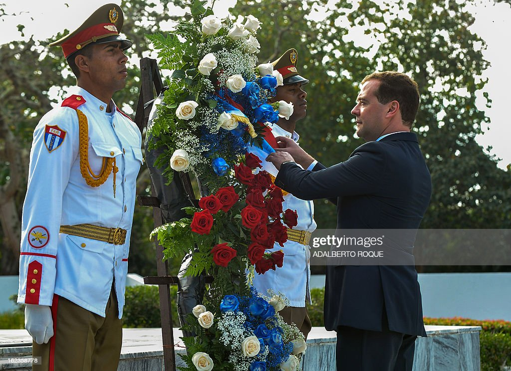 Russian Prime Minister Dmitry Medvedev is pictured during the wreath-laying ceremony before the Monument to the Soliet Soldier at the old Soviet military cemetery in Havana, on February 22, 2013. Medvedev met with Castro for trade and energy talks as he kicked off a three-day visit to the communist island. AFP PHOTO/ADALBERTO ROQUE