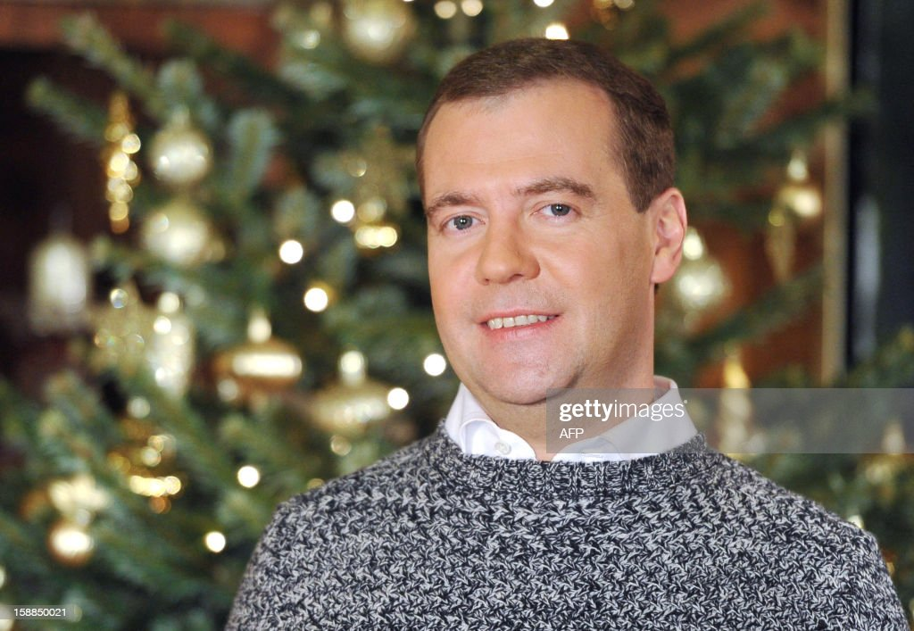 Russian Prime Minister Dmitry Medvedev is pictured in Gorki residence outside Moscow during a recording of a New Year's video address on December 28, 2012. AFP PHOTO / RIA POOL / ALEXANDER ASTAFEV